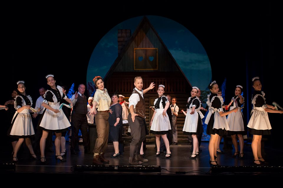 the cast perform the musical number 'Buy me a hotel'
